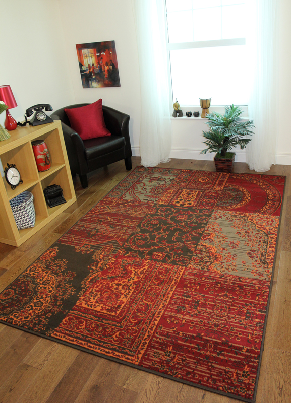 Warm red brown orange grey patchwork traditional rug cosy for Warm rugs